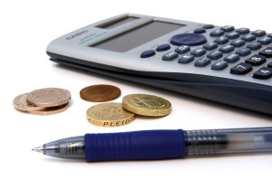 Calculator, money and pen